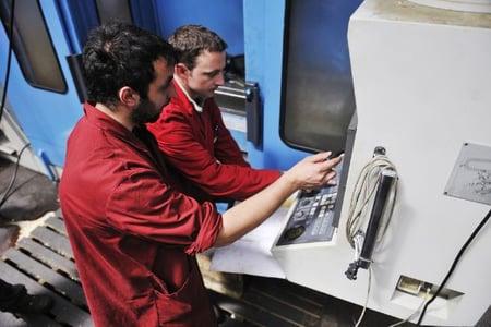 engineering people manofacturing industry with big modern computer mashines