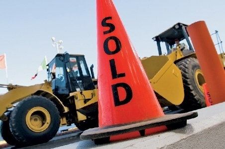 "cone with ""sold"" sign"
