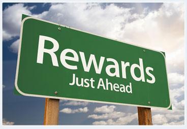 street sign of rewards ahead